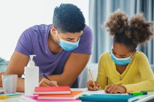 Volunteer tutoring a child